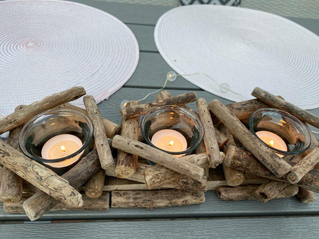 Grillikatoksen viimeistely. Uniikkitehtaan kynttilä-asetelma.